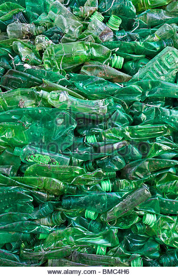 crushed-green-plastic-bottle-waste-at-a-waste-recycling-plant-bmc4h6